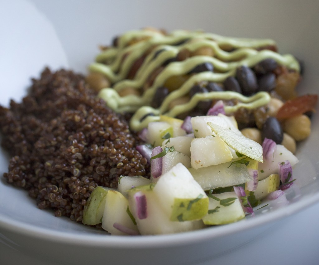 Vegetarian taco bowls with fresh pears and avocado creme