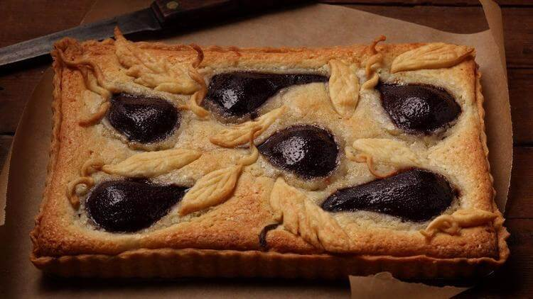 What to do with fall pears: Poach in wine, stick into an almond tart