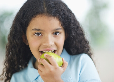 girl eating pear