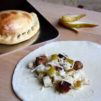 pear-sausage-and-fontina-calzones